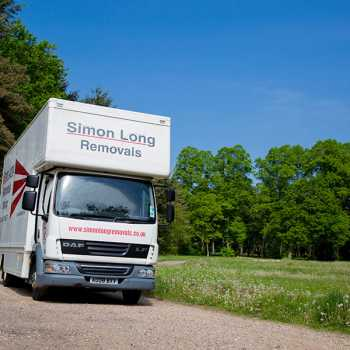 Simon long removals van on a country lane