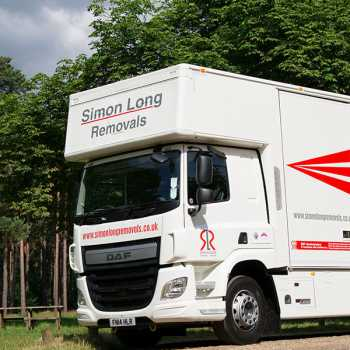 A large white and red Simon Long removals van